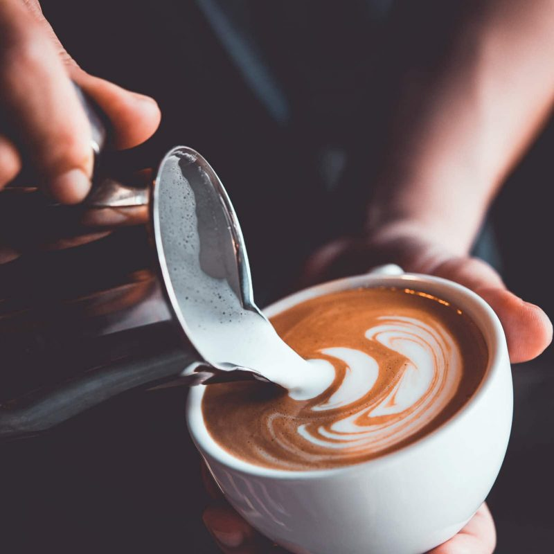 Vintage,Tone,Of,Some,People,Pour,Milk,To,Making,Latte